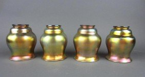 FOUR GOLD FAVRILE GLASS SHADES