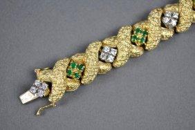 GOLD, DIAMOND AND EMERALD BRACELET, 2.40CTW