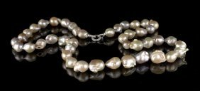 Long Strand Of Multi-Colored Baroque Pearls