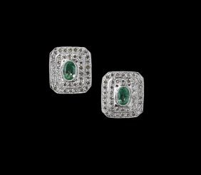 18 Kt. White Gold, Emerald And Diamond Earrings