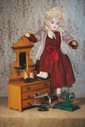 "ANTIQUE WOODEN DOLL DRESSER. 24""H. X 14"" W. Pi"