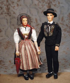 "PAIR CARVED SWISS WOODEN-TYPE DOLLS. 14"". Carv"
