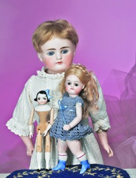 CLOSED-MOUTH GERMAN BISQUE DOLL.  Marks: None.  15