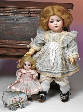 GERMAN ALL-BISQUE DOLL WITH MINIATURE TIN DOLL BUG