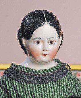 RARE, CIRCA 1865 BROWN-EYED CHINA WITH EYELASHES.