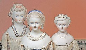 THREE EMMA CLEAR PARIAN DOLLS WITH DECORATED HAIR