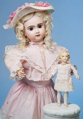 KATHY REDMOND BISQUE DOLL WITH LAVISH EMBELLISHMENT