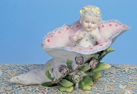 """GERMAN BISQUE FIGURINE OF """"BABY IN FLORAL HORN"""
