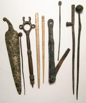 A Collection Of Ancient Bronze And Bone Implements