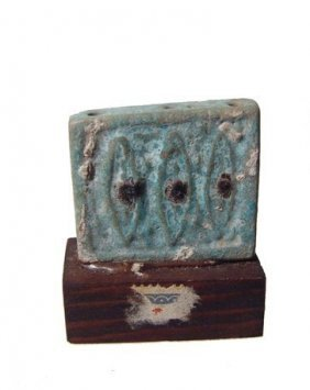 Egyptian Bicolor Faience Plaque Depicting Three Eyes Of