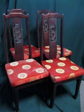 FOUR CARVED BACK DINING CHAIRS