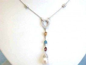 Gold Necklace With Pearl, Diamonds And Gemstone Pendant