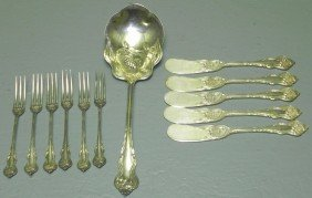 12 Pieces Silver Plate Flatware.