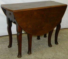 19th C. French Walnut Eight Leg Drop Leaf Table.