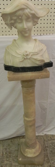 Marble Bust Of Young Lady On Marble Stand.