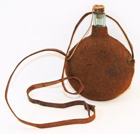 OLD CLOTH COVERED GLASS CANTEEN