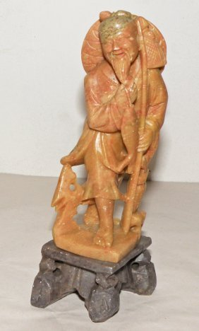 CARVED SOAPSTONE OF A FISHERMAN
