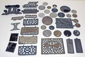 THIRTY-NINE CAST IRON STOVE PIECES