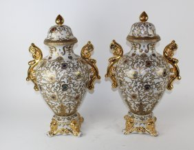 Pair Of Lidded Porcelain Urns With Gold Accents