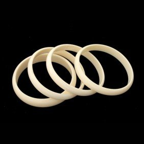 COLLECTION OF FOUR IVORY BANGLE BRACELETS.