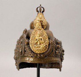 A Nepalese Parcel-Gilt Copper Ritual Helmet, 19th