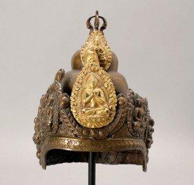 A Nepalese Parcel-Gilt Copper Ritual Helmet, 19th