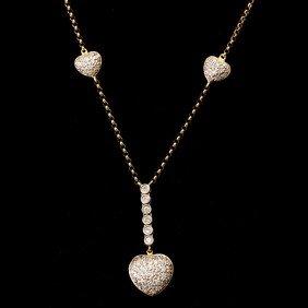 DIAMOND, 14K GOLD HEART NECKLACE.