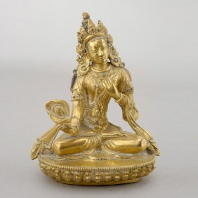 A Sino-Tibetan Gilt Bronze Figure Of Sitapatra
