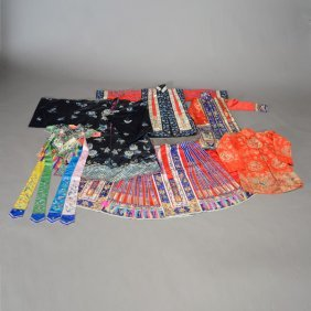 A Large Group Of Embroidered Garments