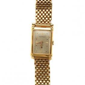 Movado 14k Yellow Gold Wristwatch.