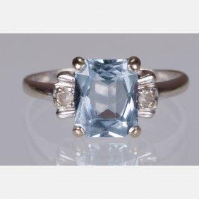 A 10kt. White Gold, Aquamarine And Diamond Ring,