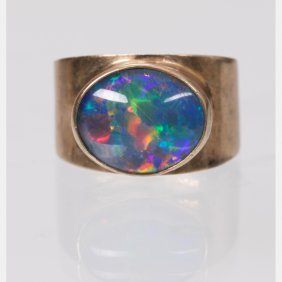 A 9kt. Yellow Gold And Opal Ring,