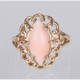 A 14kt. Yellow Gold And Coral Ring.