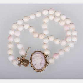 A Double Strand White And Pink Coral Beaded And Cameo