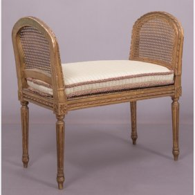 A Louis Xvi Style Gilt Carved Bench With Caned Seat And