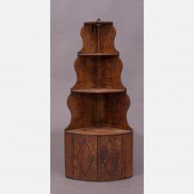 A Georgian Style Fruitwood Hanging Corner Shelf With