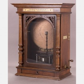An Upright Coin Operated Polyphon Disc Music Box With