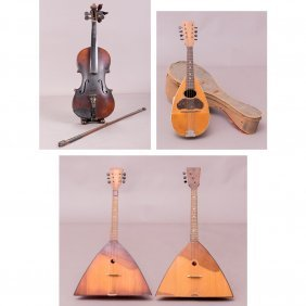 A Collection Of Four Vintage Wooden Musical