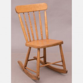 An American Pine Rocking Chair, 19th Century.