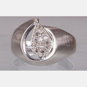 A 14kt. White Gold And Diamond Melee Ring,