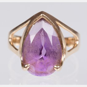A 14kt. Yellow Gold And Amethyst Ring.