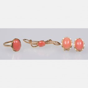 An 18kt. Yellow Gold And Coral Ring,