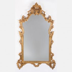 A Louis Xv Style Gilt Carved Mirror, 20th Century.
