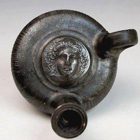 Greek Black-Glaze Guttos With Medusa