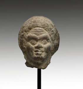 A Roman-Egypt Head Of A Woman