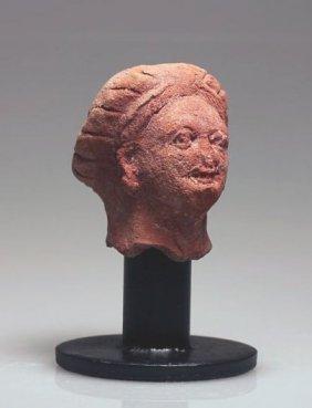 A Roman-Egyptian Head Of A Woman