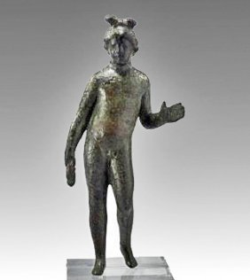 A Roman Bronze Figure Of A Youth