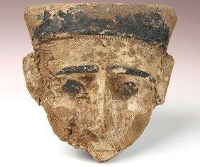 An Egyptian Wood And Polychrome Mummy Mask