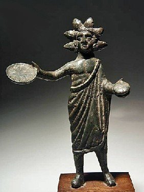 An Etruscan Bronze Statuette Of A Priest