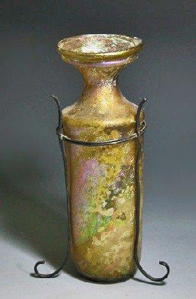 A Roman Yellow Glass Cylindrical Jar
